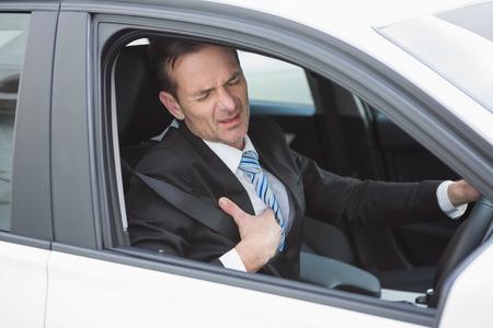 heartache: Businessman suffering from heartache in his car