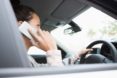 mobile phone adult: Young businesswoman on the phone in her car Stock Photo