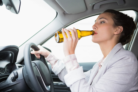 life threatening: Woman drinking beer while driving in her car