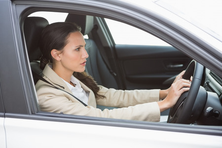 road rage: Businesswoman honking the horn in her car Stock Photo