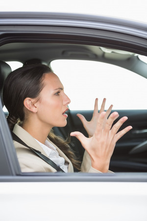 rage: Young woman experiencing road rage in her car