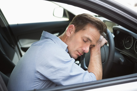 slumped: Drunk man slumped on steering wheel in his car