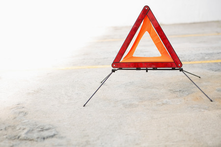 empty tank: Close up on triangle warning sign in a car park