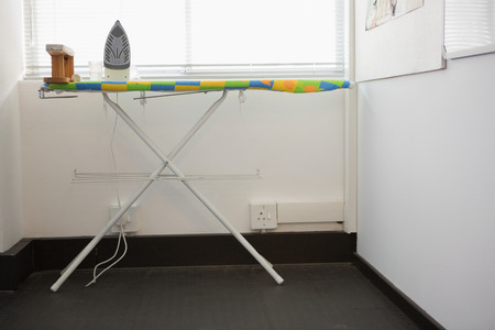 ironing board: Ironing board with an iron in college