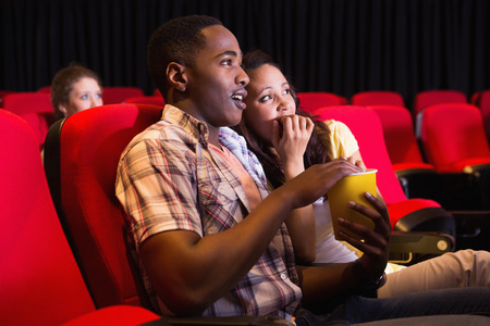 cinema people: Young couple watching a film at the cinema