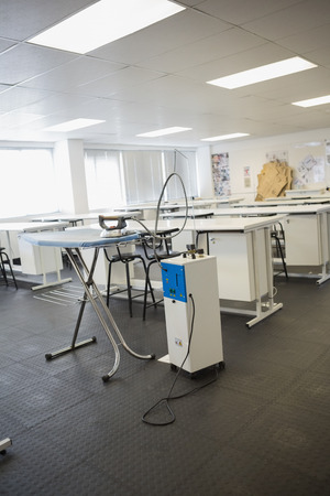 ironing board: Empty class room with ironing board in college Editorial