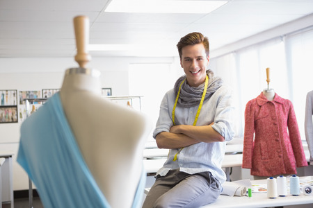 fashion clothing: Fashion student sitting with arms crossed at the college Stock Photo