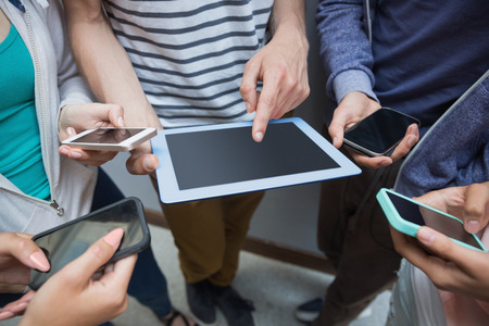 digital tablet: Students using tablet pc and their smartphones at the university