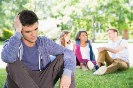 excluded: Lonely student feeling excluded on campus at the university Stock Photo
