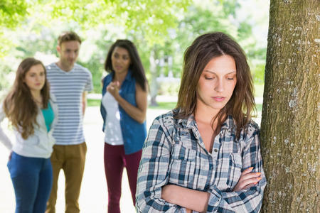 social outcast: Lonely student being bullied by her peers at the university Stock Photo