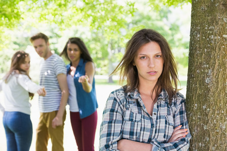 Lonely student being bullied by her peers at the university photo