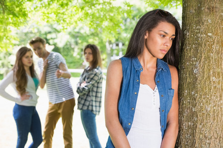 bullied: Lonely student being bullied by her peers at the university Stock Photo