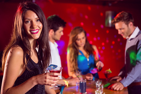 night out: Happy friends on a night out together at the nightclub Stock Photo