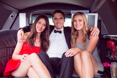 limo: Pretty girls with ladies man in the limousine on a night out Stock Photo