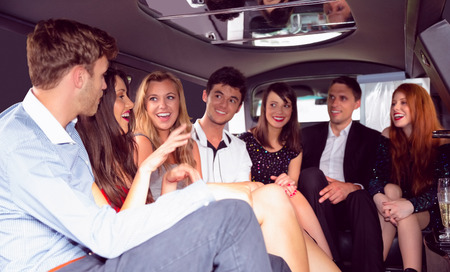 limo: Happy friends chatting in limousine on a night out