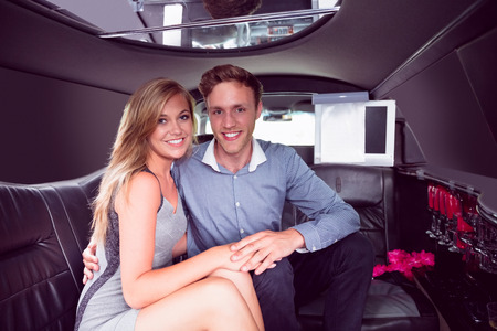 limo: Happy couple smiling in limousine on a night out Stock Photo