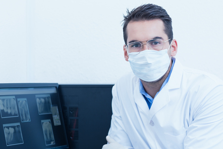 surgical mask: Portrait of male dentist wearing surgical mask