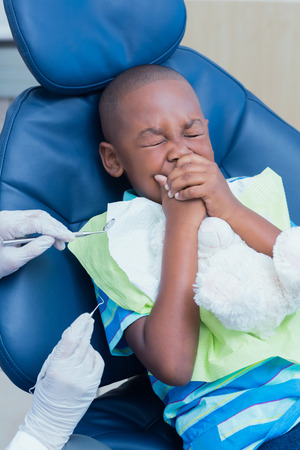 examined: Close up of boy having his teeth examined by a dentist