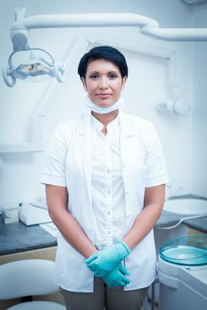 surgical coat: Portrait of confident female dentist