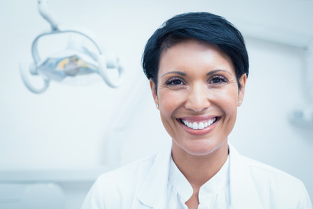 dentist woman: Close up portrait of happy confident female dentist Stock Photo