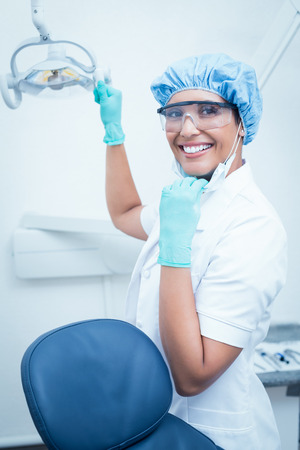 surgical cap: Portrait of female dentist wearing surgical cap and safety glasses