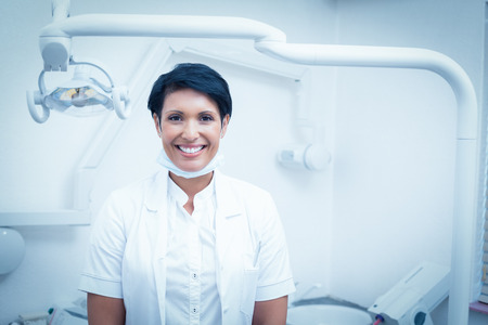 surgical coat: Portrait of happy confident female dentist