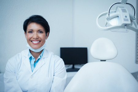 dental clinics: Portrait of smiling young female dentist