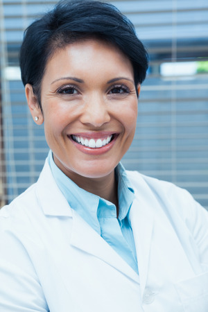 professional portrait: Portrait of smiling young female dentist