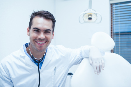 young male: Portrait of smiling young male dentist Stock Photo