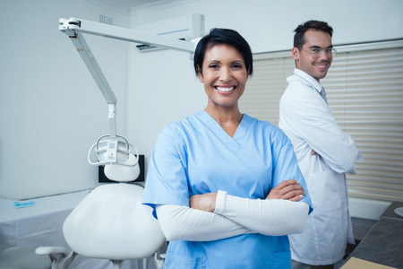 a dentist: Portrait of smiling male and female dentists