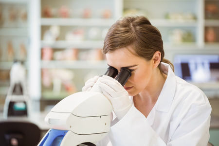 medical research: Young scientist working with microscope at the university