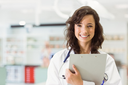 Pretty medical student smiling at camera at the university
