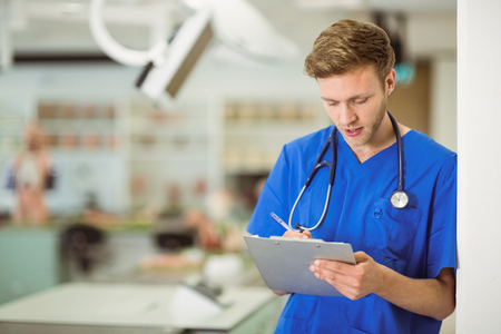 Young medical student writing notes at the university Stock Photo