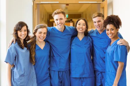 医学部の学生が大学でカメラに笑顔 写真素材