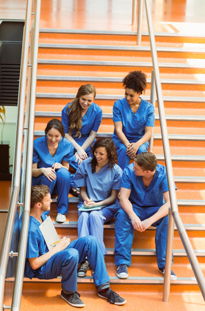 medical students: Medical students chatting on the steps at the university Stock Photo