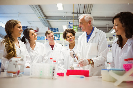 Students watching lecturer in the lab at the university Standard-Bild