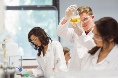 computer science class: Science students working in the laboratory at the university Stock Photo
