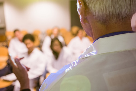 lecturing: Science professor giving lecture to class at the university Stock Photo