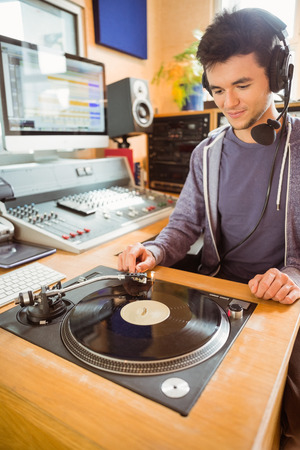 turn table: Portrait of an university student with a turn table in the studio of a radio