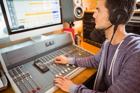 Portrait of an university student mixing audio in a studio of a radio Stockfoto