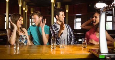 weekend activities: Happy friends excited for weekend activities in a bar