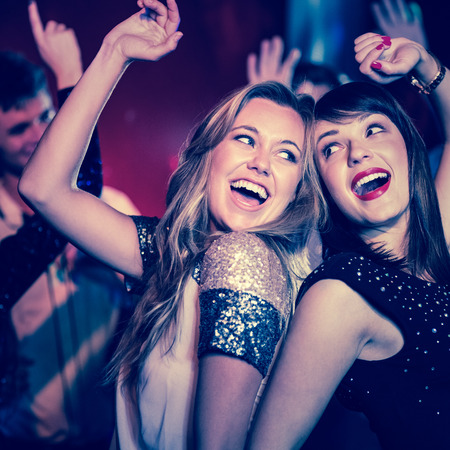Happy friends having fun together at the nightclub Imagens