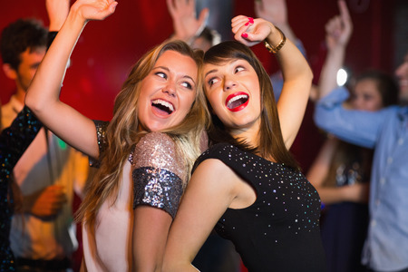 dancing club: Happy friends having fun together at the nightclub Stock Photo