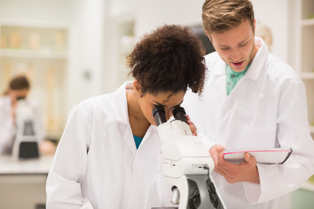 medical students: Medical students working with microscope at the university