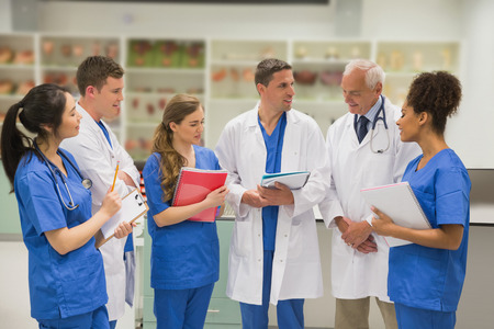 Medical professor talking with students at the university Stock Photo
