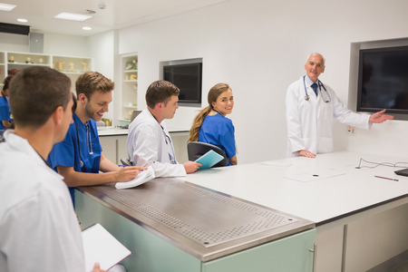 lecturing: Medical professor teaching young students at the university