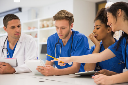 Medical students sitting and talking at the university Stock Photo