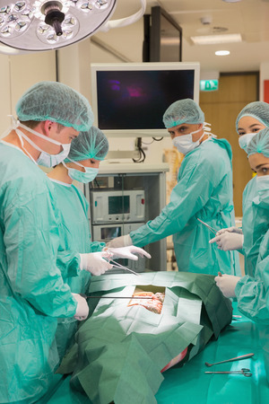 medical students: Medical students practicing surgery on model at the university Stock Photo