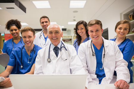lecturing: Medical students and professor using laptop at the university Stock Photo
