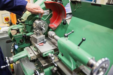 heavy machinery: Engineering student using heavy machinery at the university